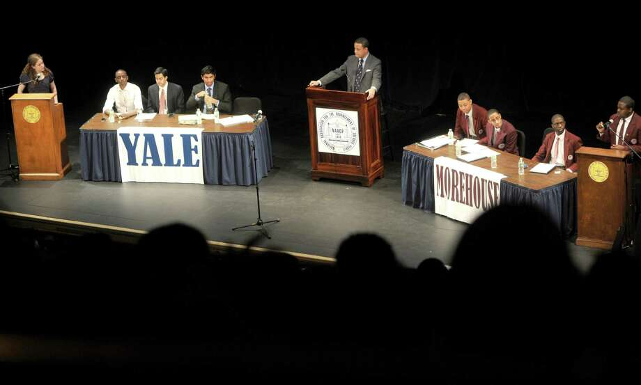 **WITH SLIDESHOW:The Yale University and Morehouse College debate teams go head to head debating Gun Control and the efficacy of Charter Schools during the Connecticut NAACP  5th Annual Great Debate Thursday April 11, 2013 at the Shubert Theater in New Haven, Connecticut.  Photo by Peter Hvizdak / New Haven Register Photo: New Haven Register / ©Peter Hvizdak /  New Haven Register