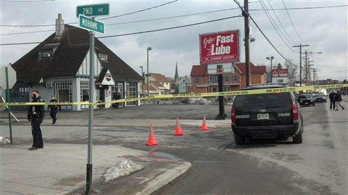 Emergency crews work at the scene of a shooting at Gaffey's car wash in the village of Herkimer, N.Y. after shootings at two different businesses left four people dead and at least two wounded, according to police, Wednesday, March 13, 2013. Police said two unidentified people were shot and killed at the car wash and two others were killed in a barber shop in the village of Mohawk, east of Syracuse. (AP Photo/Observer-Dispatch, Rocco Laduca)