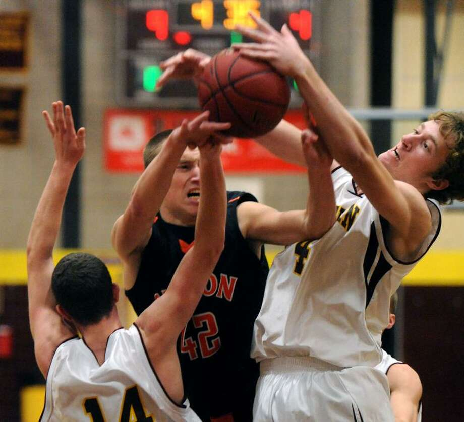 It's a scramble: Sheehan's Jon Beale, left, and Justin Lange, right, and Shelton's Ben Malay center during Sheehan's 71-60 win Friday. Mara Lavitt/New Haven Register