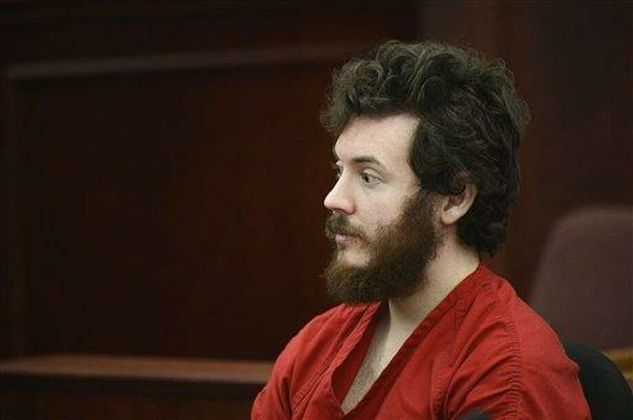 James Holmes, Aurora theater shooting suspect, sits in the courtroom during his arraignment in Centennial, Colo., on Tuesday, March 12, 2013. Judge William Blair Sylvester entered a not guilty plea on behalf of James Holmes on Tuesday after the former graduate student's defense team said he was not ready to enter one. (AP Photo/Denver Post, RJ Sangosti, Pool) Photo: AP / Pool Denver Post
