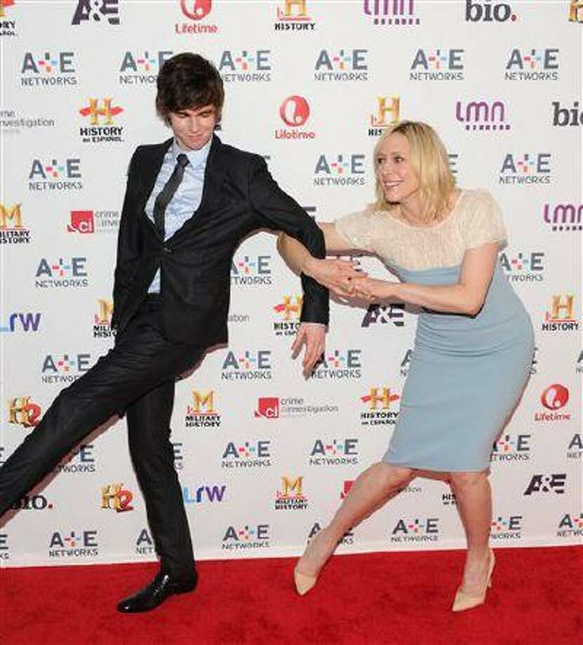 "Cast members Freddie Highmore and Vera Farmiga from ""Bates Motel"" attend the A+E Networks 2013 Upfront on Wednesday, May 8, 2013 in New York. Photo: Evan Agostini/Invision/AP / Invision"