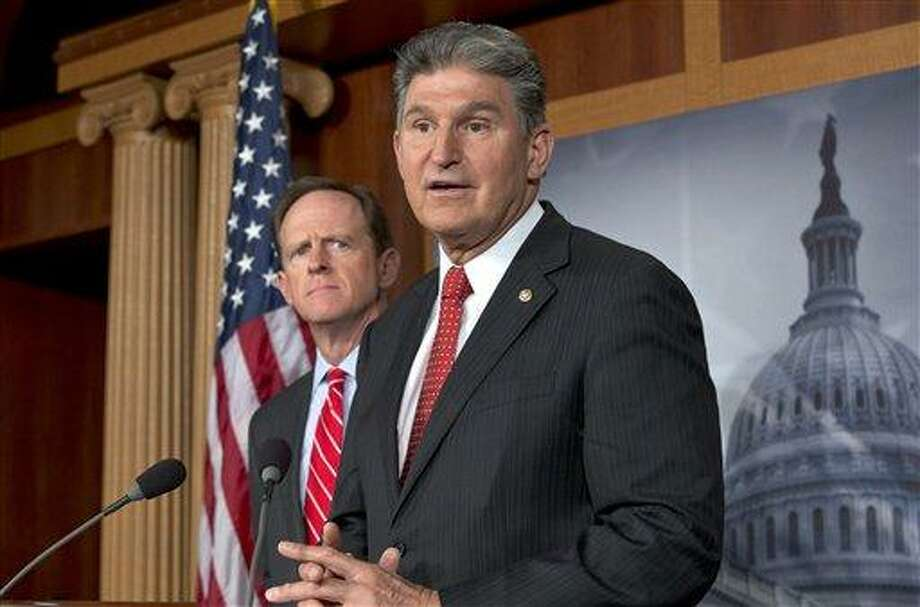"Sen. Joe Manchin, <a href=""http://D-W.Va"">D-W.Va</a>., right, accompanied by Sen. Patrick Toomey, R-Pa., announce that they have reached a bipartisan deal on expanding background checks to more gun buyers, Wednesday, April 10, 2013, on Capitol Hill in Washington.  (AP Photo/J. Scott Applewhite) Photo: AP / AP"