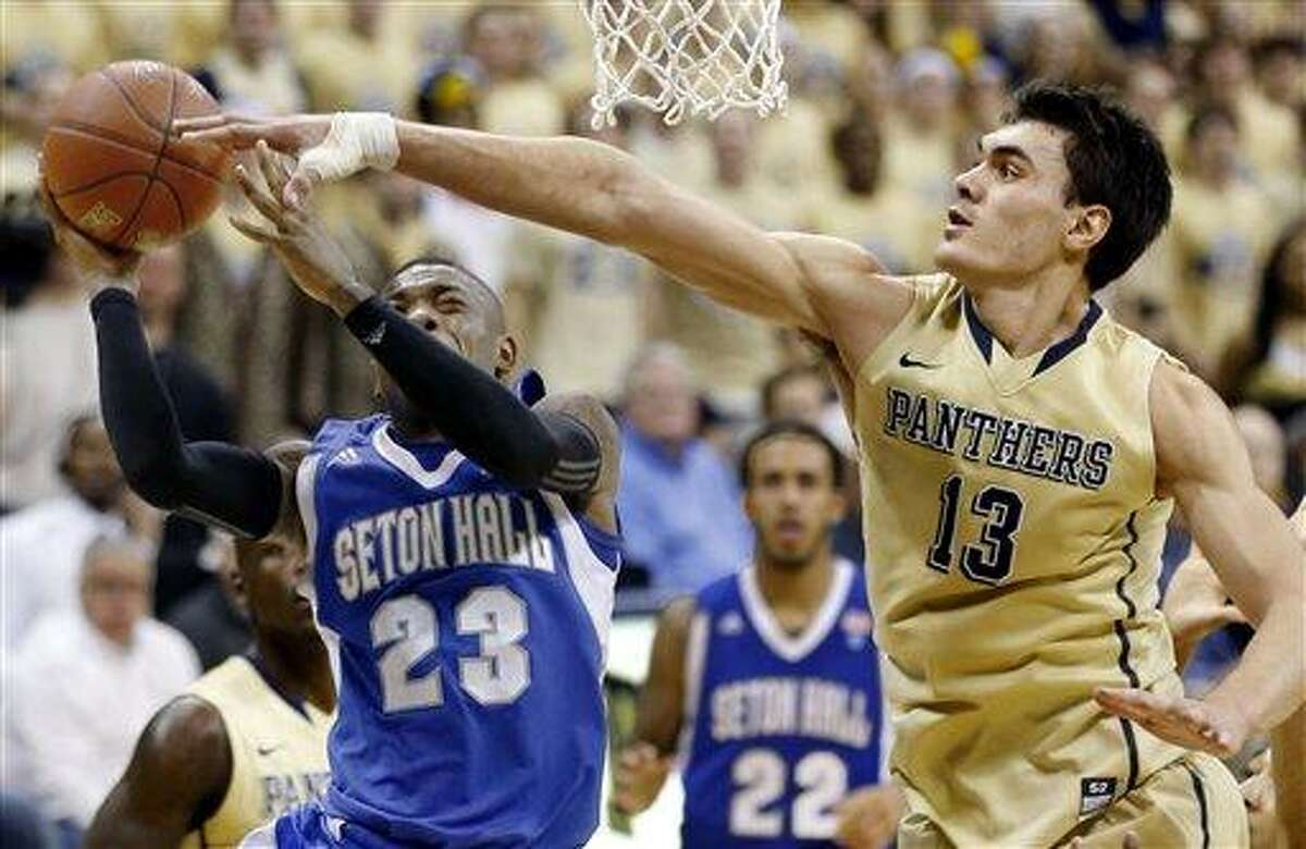Pittsburgh's Steven Adams (13) blocks a shot by Seton Hall's Fuquan Edwin (23) in the second half of the NCAA college basketball game on Monday, Feb. 4, 2013 in Pittsburgh. Pittsburgh won 56-46. (AP Photo/Keith Srakocic)