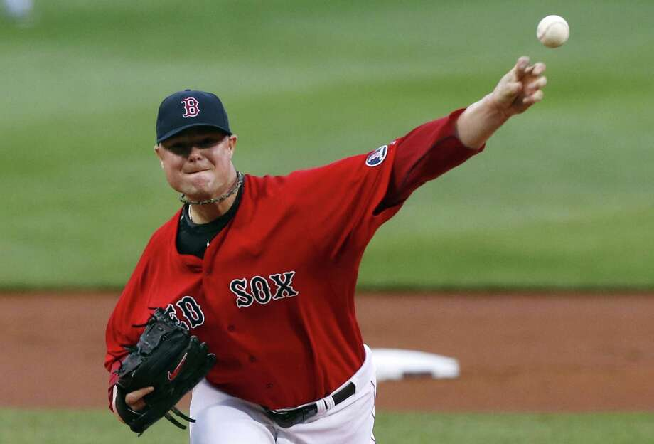 Boston Red Sox's Jon Lester pitches in the first inning of a baseball game against the Toronto Blue Jays in Boston, Friday, May 10, 2013. (AP Photo/Michael Dwyer) Photo: AP / AP