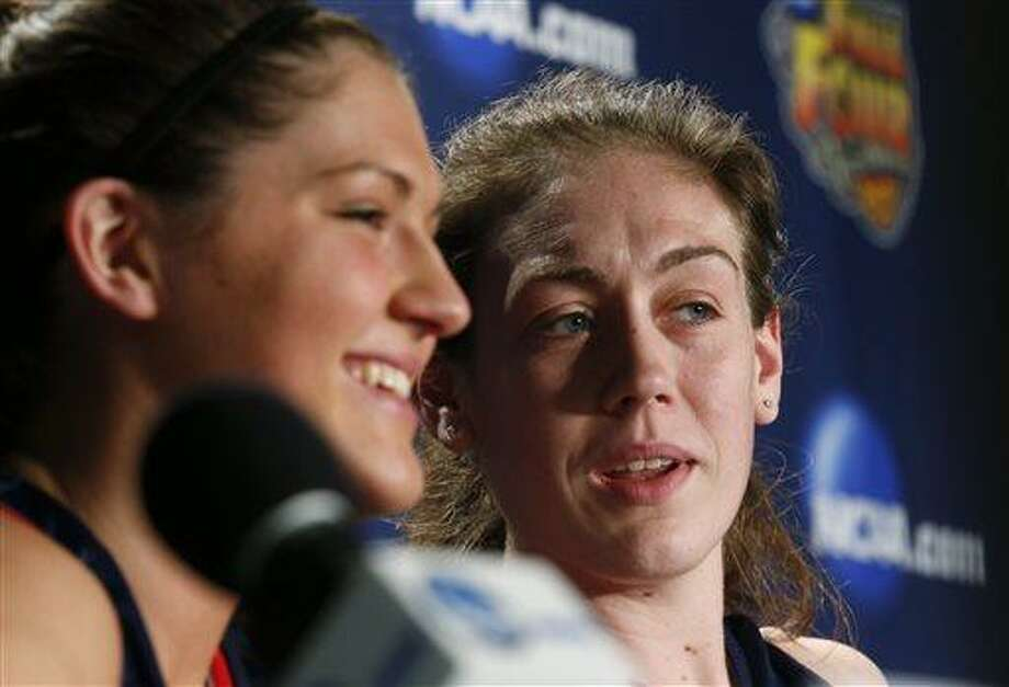 Connecticut's Stefanie Dolson, left,  and Breanna Stewart talk during a news conference for the women's NCAA Final Four college basketball tournament final, Monday, April 8, 2013, in New Orleans. UConn plays Louisville in the championship game on Tuesday.  (AP Photo/Dave Martin) Photo: AP / AP