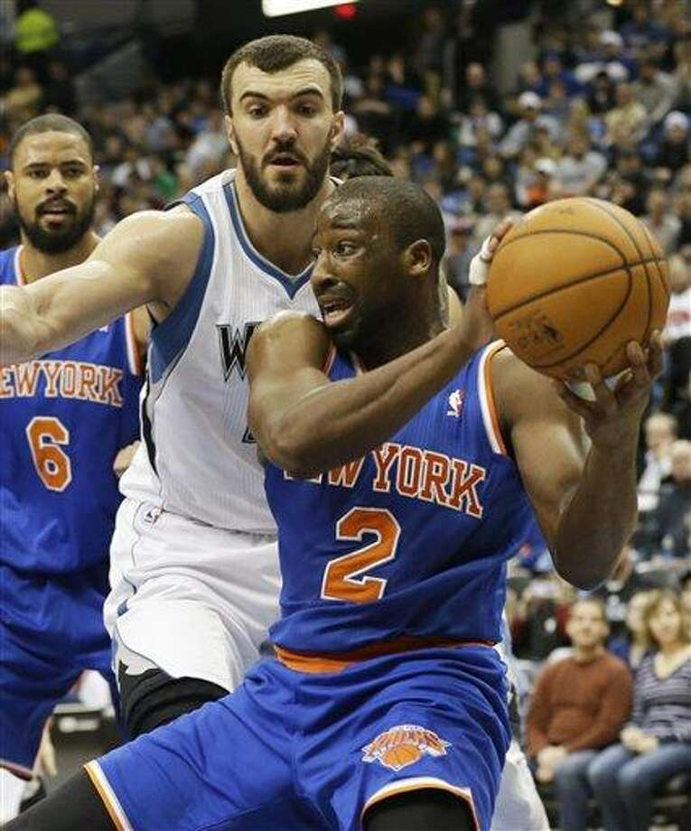 New York Knicks' Raymond Felton, right, controls the ball as Minnesota Timberwolves' Nikola Pekovic of Montenegro defends in an NBA basketball game against the Minnesota Timberwolves Friday, Feb. 8, 2013 in Minneapolis. (AP Photo/Jim Mone) Photo: ASSOCIATED PRESS / AP2013