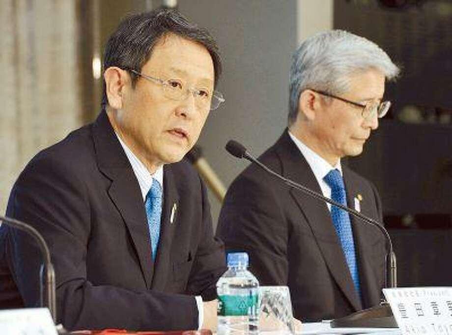 Toyota President Akio Toyoda, left, and Executive Vice President Nobuyori Kodaira answer questions from reporters at a new conference Wednesday in Tokyo. Illustrates TOYOTA (category f) by Hajimi Yamagishi (c) 2013, The Yomiuri Shimbun. Moved: Thursday, May 9, 2013 (MUST CREDIT: Yomiuri Shimbun photo).