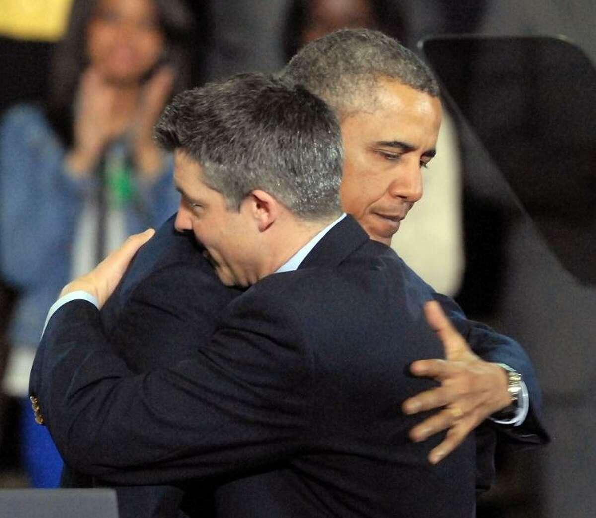 University of Hartford, West Hartford: President Barack Obama hugs Ian Hockley, father of Dylan, before Obama was to speak on gun control. Mara Lavitt/New Haven Register4/8/13