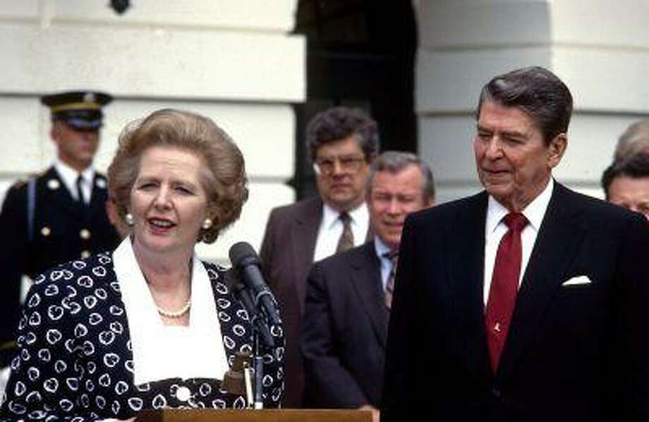 In a Friday, July 17, 1987 file photo, Prime Minister Margaret Thatcher of the United Kingdom, left, makes remarks after visiting United States President Ronald Reagan, right, at the White House in Washington, D.C. Photo: ASSOCIATED PRESS / A2008