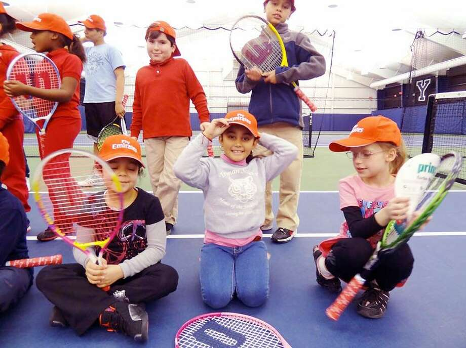 More than 100 racquets were collected as part of the Emirates Airlines Racquet Return program during the 2012 New Haven Open at Yale and refurbished for kids from New Haven Youth Tennis & Education. Some of the children received them recently at an event at the Cullman-Heyman Tennis Center. (Photo courtesy of New Haven Open)