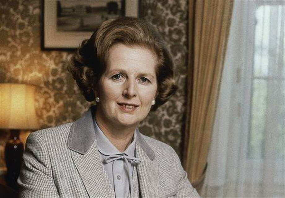 FILE - This is a 1980 file photo showing  British Prime Minister Margaret Thatcher. Thatcher's former spokesman, Tim Bell, said Thatcher died of a stroke Monday morning, April 8, 2013. She was 87. (AP Photo/Gerald Penny, File) Photo: AP / AP