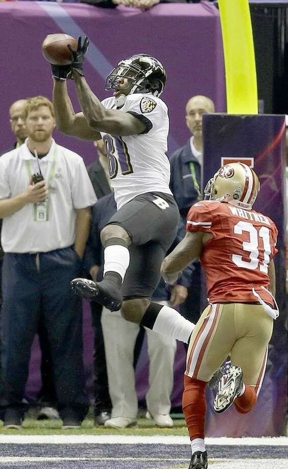 Baltimore Ravens wide receiver Anquan Boldin (81) makes a 13-yard touchdown reception against San Francisco 49ers safety Donte Whitner (31) during the first half of the NFL Super Bowl XLVII football game, Sunday, Feb. 3, 2013, in New Orleans. (AP Photo/Elaine Thompson) Photo: AP / AP2013