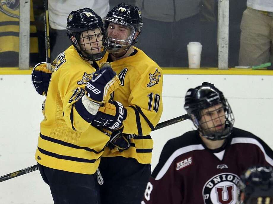 Quinnipiac left wing Matthew Peca, left, and center Connor Jones (10) are both past winners of top forward award at the Royal Bank Cup, the biggest event in Canadian Junior Hockey. AP Photo/Steven Senne) Photo: AP / 2013 AP