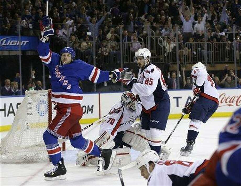New York Rangers right wing Ryane Clowe (29) celebrates a goal scored by New York Rangers left wing Carl Hagelin (not shown) in the second period of Game 4 of their first-round NHL Stanley Cup playoff series in New York, Wednesday, May 8, 2013.  (AP Photo/Kathy Willens) Photo: AP / AP