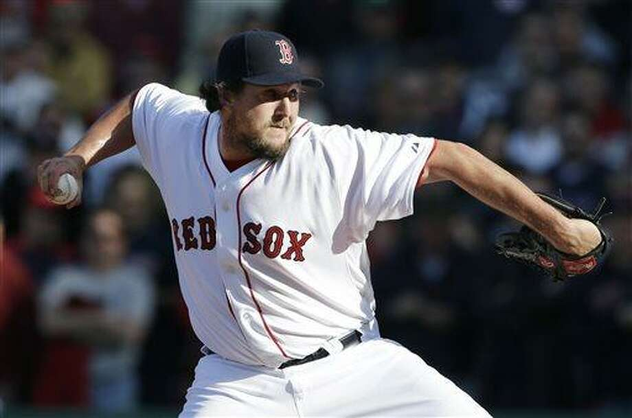 FILE - In this April 8, 2013, file photo, Boston Red Sox relief pitcher Joel Hanrahan delivers to the Baltimore Orioles during a baseball game at Fenway Park in Boston. Hanrahan is expected to be sidelined at least two months and is scheduled to visit Dr. James Andrews for an examination that could determine whether he will need surgery. Boston transferred Hanrahan from the 15- to the 60-day disabled list Thursday, May 9, 2013, with what the Red Sox said was a strained right forearm. (AP Photo/Elise Amendola, File) Photo: AP / AP