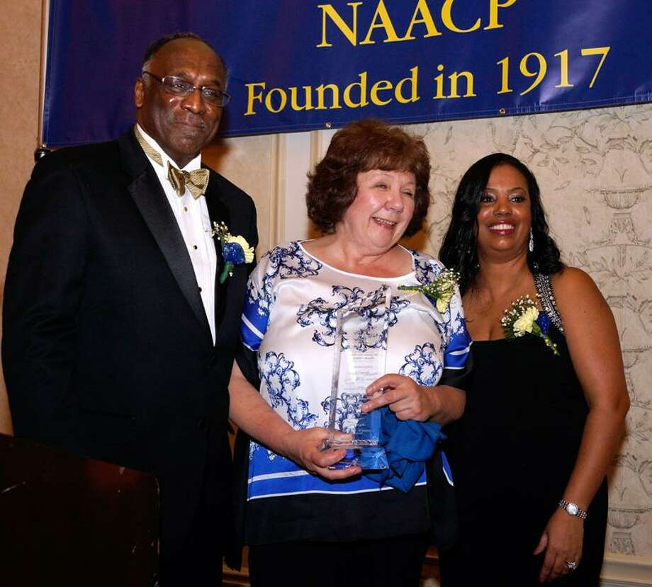 """New Haven--2013 NAACP Media award winner Pamela McLoughlin Ruddull  with James Rawlings (president), left, and Doris Dumas (chairman) at the Greater New Haven Branch NAACP 96th Annual Freedom Fund Dinner. The event was held at the Omni Hotel in New Haven. Photo-Peter Casolino/Register <a href=""""mailto:pcasolino@newhavenregister.com"""">pcasolino@newhavenregister.com</a>"""