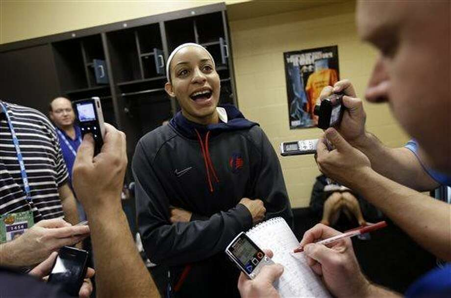 Connecticut guard Bria Hartley talks to reporters in the locker room before practice for the women's NCAA Final Four college basketball tournament final, Monday, April 8, 2013, in New Orleans. UConn plays Louisville in the championship game on Tuesday.  (AP Photo/Gerald Herbert) Photo: AP / AP