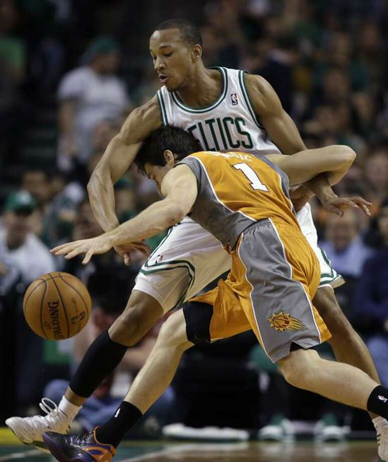 Phoenix Suns point guard Goran Dragic (1) crashes into Boston Celtics guard Avery Bradley as he tries control the ball during the first quarter of an NBA basketball game in Boston, Wednesday, Jan. 9, 2013. (AP Photo/Elise Amendola) Photo: AP / AP