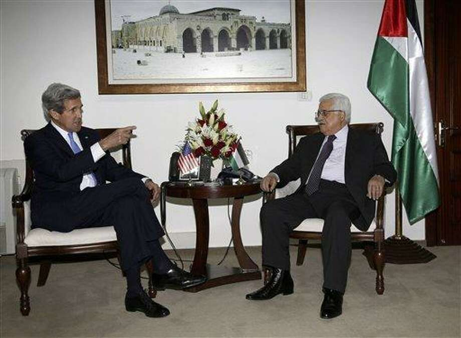 Palestinian President Mahmoud Abbas, right, meets with U.S. Secretary of State John Kerry in the West Bank city of Ramallah Sunday, April 7, 2013. (AP Photo/Mohamed Torokman, Pool) Photo: AP / REUTERS POOL