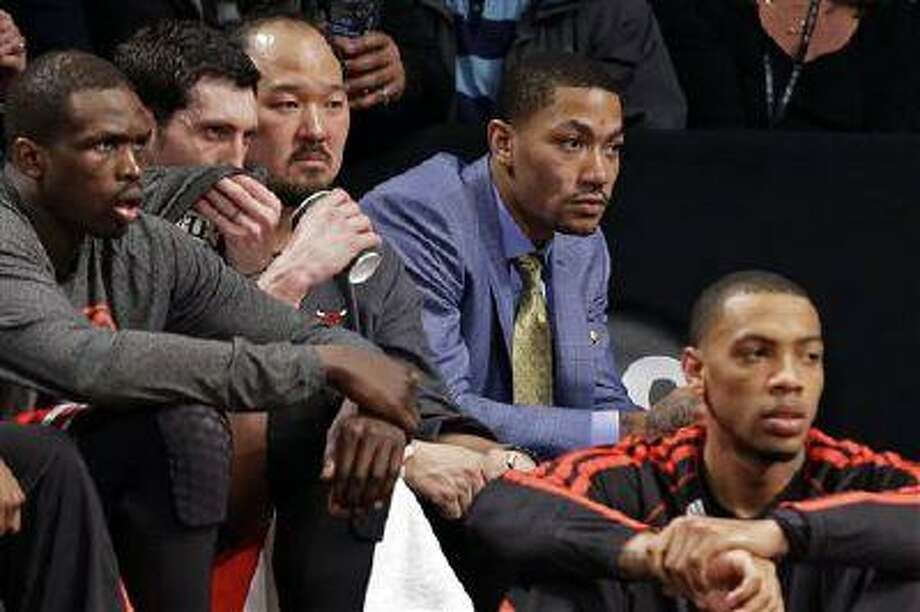 Chicago Bulls guard Derrick Rose, second from right, watches from the bench during the second half of Game 2 of a first-round NBA playoff series against the Brooklyn Nets, April 22, 2013, in New York. Photo: AP / AP