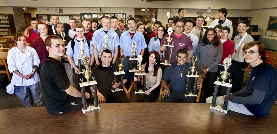 Platt Tech trophy winners from the recent Skills USA competition gather in the library. Ten of them are going on to the national finals, in June. The trip will cost about $1,000 per student. They are raising funds for the trip.   Melanie Stengel/Register