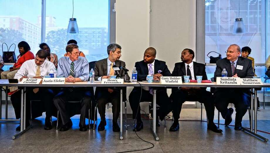 "New Haven--Mayoral candidates the discuss social issues facing New Haven during the second debate held at Gateway Community College. They are, left to right; Kermit Carolina, Justin Elicker, Henry Fernandez, Gary Holder-Winfield, Sundiata Keitazulu and Matthew Nemerson.  Photo-Peter Casolino/Register <a href=""mailto:pcasolino@newhavenregister.com"">pcasolino@newhavenregister.com</a>"