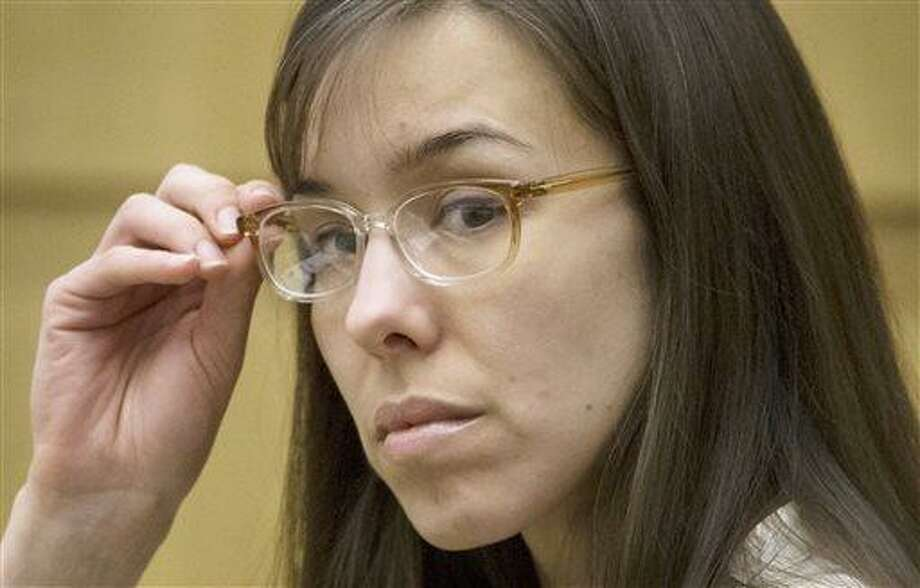 FILE - In this May 1, 2013 file photo, defendant Jodi Arias sits in the courtroom during her trial at Maricopa County Superior Court in Phoenix.  It has become a real-life soap opera for people around the world and dozens of fanatics who camp out on a Phoenix sidewalk to get into the show. The star is none other than a small-town waitress who killed her lover. Jodi Arias has been on trial since January, and her case has developed an enormous following with its tales of sex, violence and betrayal. (AP Photo/The Arizona Republic, Mark Henle, Pool, File) Photo: AP / POOL The Arizona Republic