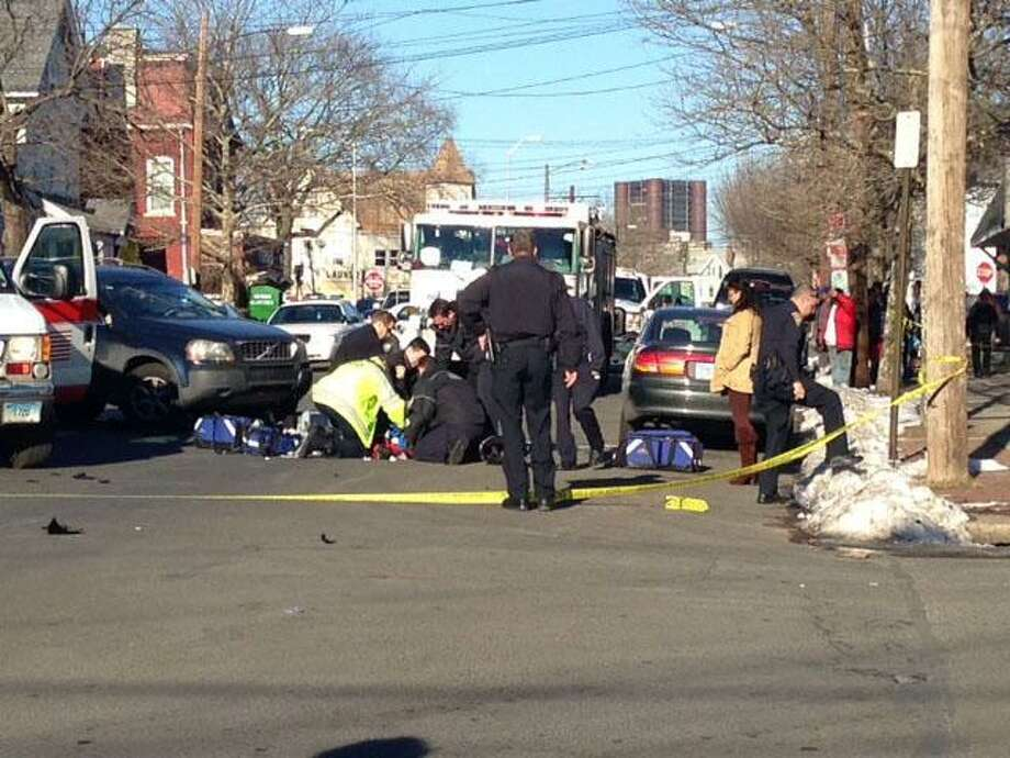 The scene of an accident involving a motorcycle and a SUV on Kimberly Avenue in New Haven Monday. Rich Scinto/Register