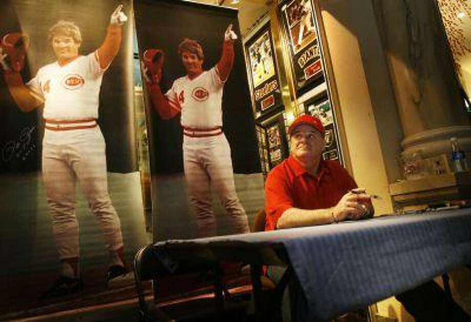 **FILE** In the Dec. 16, 2005, file photo, Pete Rose sits at a table waiting to sign autographs at Caesars Palace in Las Vegas. Rose said Tuesday that Mark McGwire, who is on the ballot for the first time, ought to be voted into baseball's Hall of Fame despite his refusal to discuss steroids. (AP Photo/Isaac Brekken, File) Photo: ASSOCIATED PRESS / AP2005