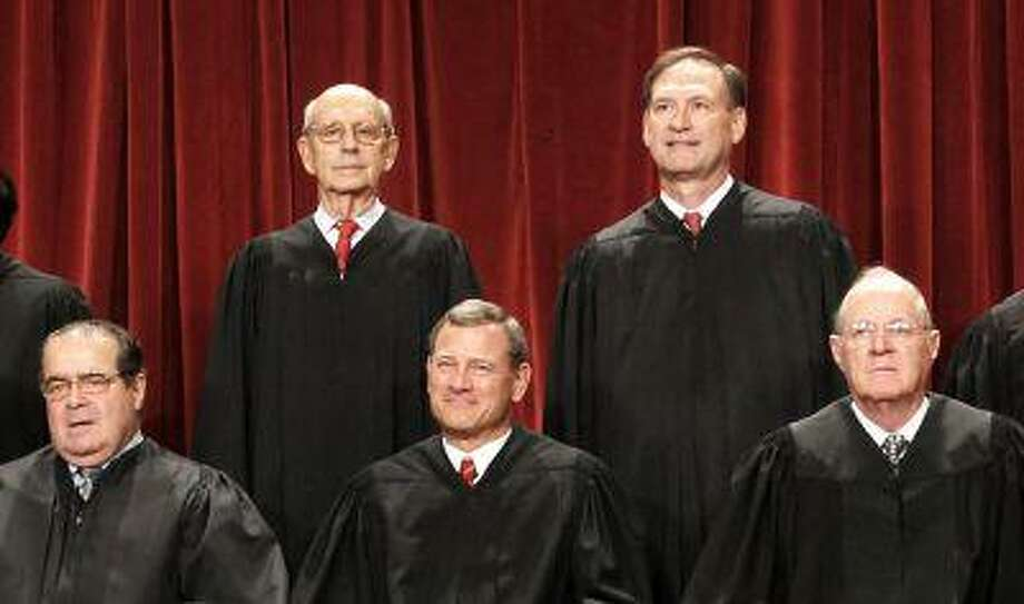 FILE - In this Oct. 8, 2010, file photo U.S. Supreme Court justices pose for a photo at the Supreme Court in Washington. Four Republican-appointed justices, front row from left, Antonin Scalia, Chief Justice John Roberts, Anthony M. Kennedy and top right, Samuel Alito Jr., control the fate of President Barack Obama's health care overhaul. For the law to stand only one of the four needs to decide that it, and its centerpiece of requiring almost every American to buy insurance or pay a penalty, passes constitutional muster. At top left is Justice Stephen Breyer. (AP Photo/Pablo Martinez Monsivais, File) Photo: ASSOCIATED PRESS / AP2010