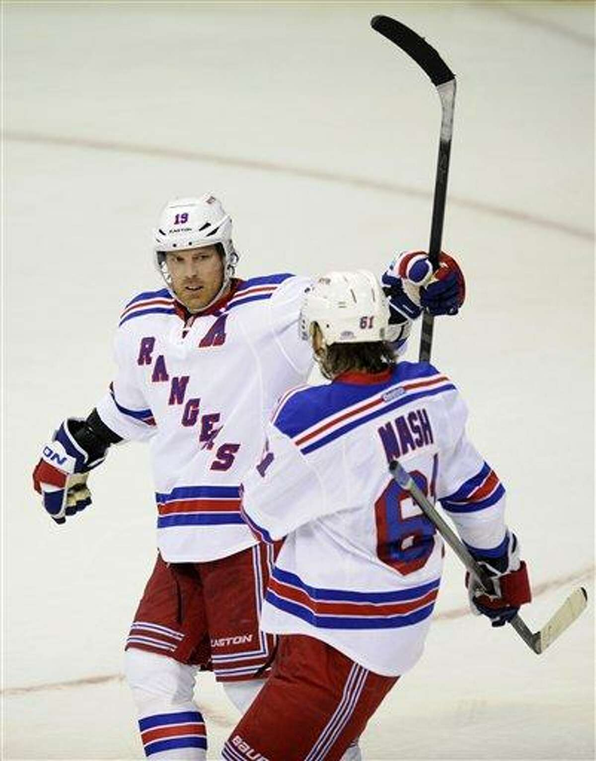 New York Rangers center Brad Richards (19) celebrates his goal with Rick Nash (61) against the Washington Capitals during the third period of an NHL hockey game Sunday March 10, 2013, in Washington. The Rangers won 4-1.(AP Photo/Nick Wass)