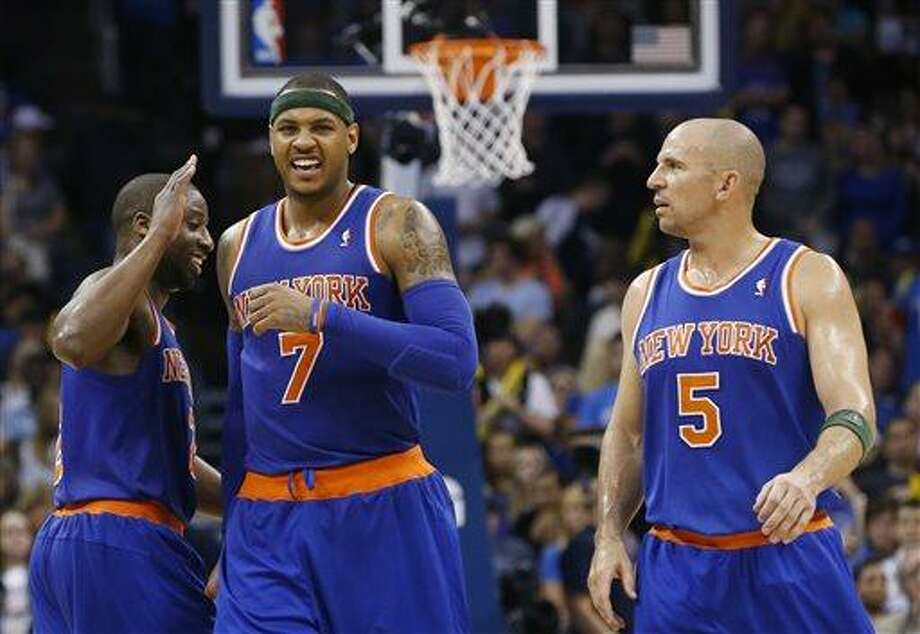 New York Knicks guard Raymond Felton (2), forward Carmelo Anthony (7) and guard Jason Kidd (5) celebrate as they walk off the court during a time out in the fourth quarter of an NBA basketball game against the Oklahoma Thunder in Oklahoma City, Sunday, April 7, 2013. New York won 125-120. (AP Photo/Sue Ogrocki) Photo: AP / AP