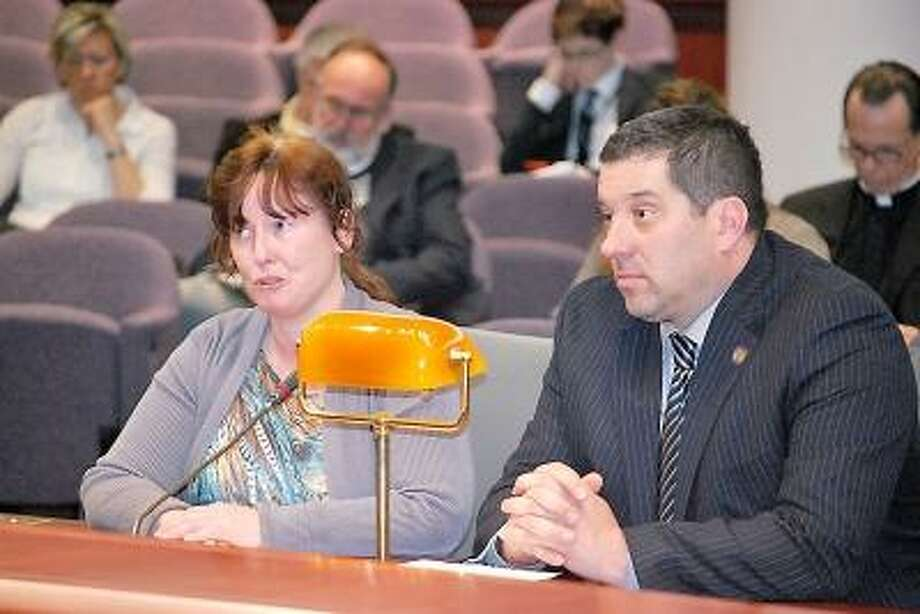 "Photo by Ricky Campbell --- Rep. Jay Case and Carol Cox, mother of the late Jerry ""Dale"" Cox, who died in a motor vehicle accident two years ago, testify at the state capitol last week."