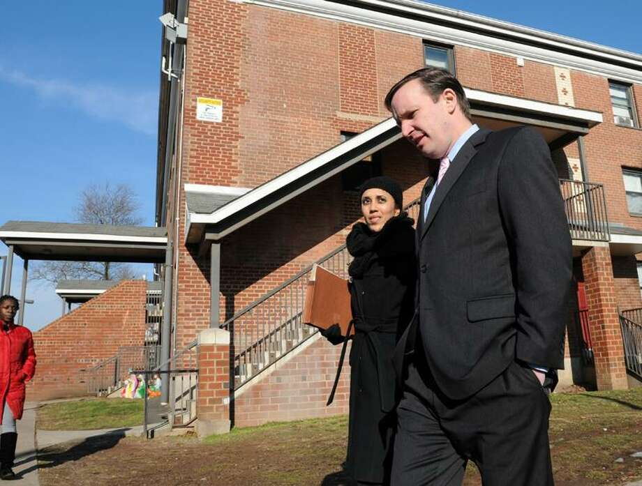 Karen DuBois-Walton, Ph.D. and Executive Director of the New Haven Housing Authority, left, walks with Connecticut's U.S. Senator Chris Murphy during a short visit to Farnam Court in New Haven, Conn.  Tuesday, January 08, 2013. According to a press release Murphy is in the area to visit with city and town officials about local projects across the Connecticut and assess federal priorities and how he can best be an advocate for them in the Senate.  Farnam Courts is a property of Elm City Communities / Housing Authority of New Haven. Photo by Peter Hvizdak / New Haven Register Photo: New Haven Register / ©Peter Hvizdak /  New Haven Register