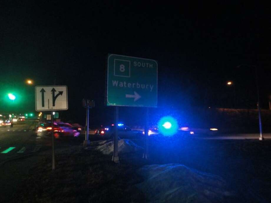 Photo by Jason Siedzik/Register Citizen ---- Police cars line the south on-ramp to Route 8 after 8 p.m. on March 10 following and accident involving an automobile and a pedestrian.