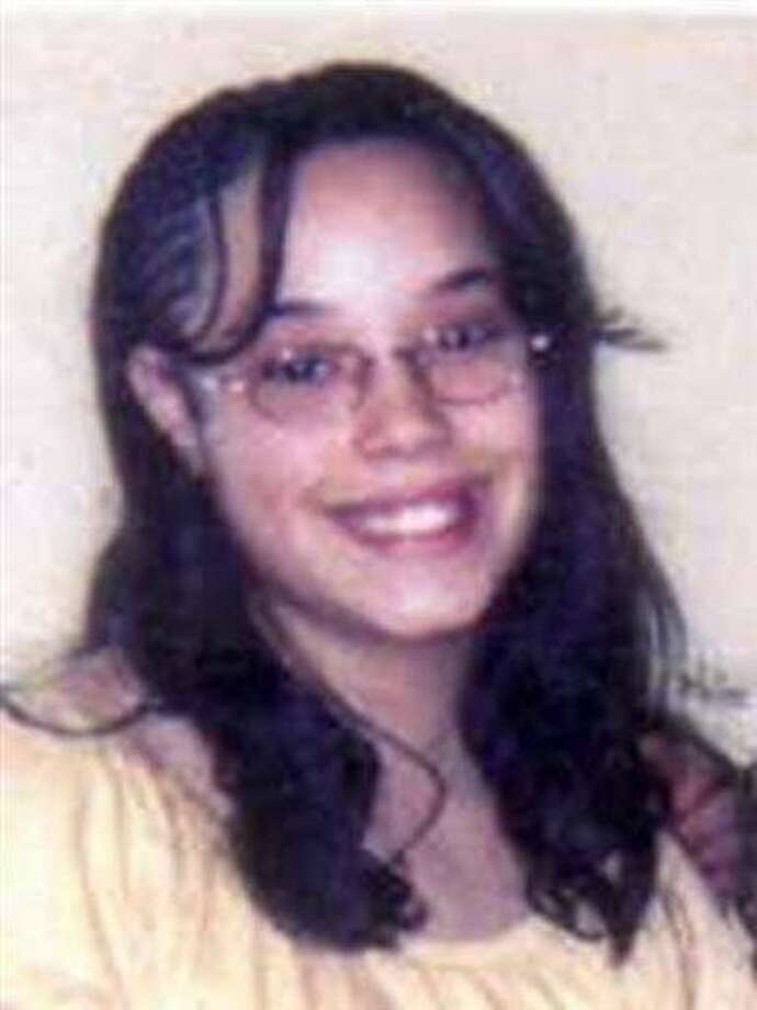 """This image provided by the FBI shows an undated photo of Georgina """"Gina"""" Dejesus. Police Chief Michael McGrath said he thinks Amanda Berry, DeJesus and Michelle Knight were tied up at the house and held there since they were in their teens or early 20s. Berry and the two other women who went missing a decade ago were found on Monday, May 6, 2013 elating family members and friends who'd longed to see them again. (AP Photo/FBI) Photo: AP / FBI"""