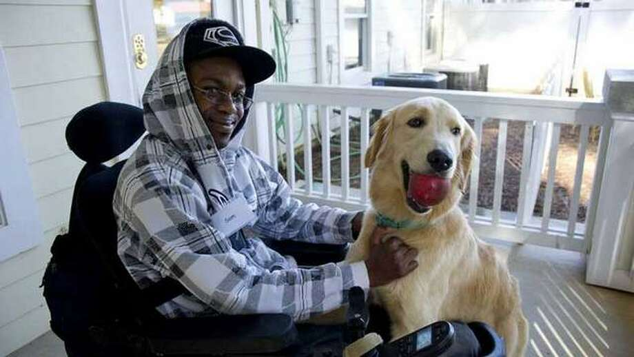 This file photo shows Sam Farr and his service dog Noble at their Oceanside, Calif. home. The Associated Press file photo.