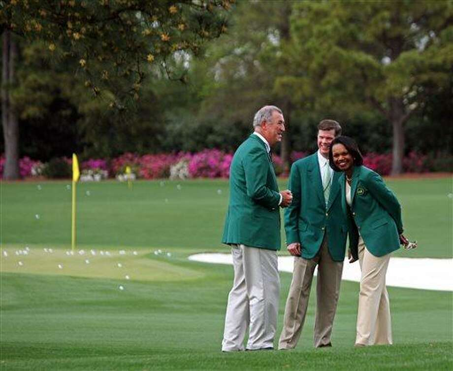 Condoleezza Rice, right, former Secretary of State and new Augusta National member, laughs on the practice range with members Dave Dorman, left, and Pat Battle, center, Sunday, April 7, 2013, at Augusta National Golf Club in Augusta, Ga. Rice and South Carolina financier Darla Moore were the first women invited to join the home course of the Masters. (AP Photo/Ron Williams) Photo: ASSOCIATED PRESS / AP2013