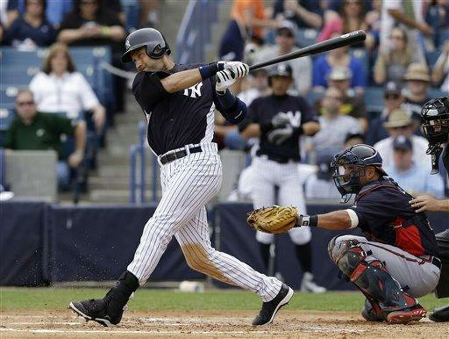 New York Yankees designated hitter Derek Jeter bats in a spring training baseball game against the Atlanta Braves at Steinbrenner Field in Tampa, Fla., Saturday, March 9, 2013. Braves catcher Gerald Laird is behind the plate. (AP Photo/Kathy Willens) Photo: AP / AP