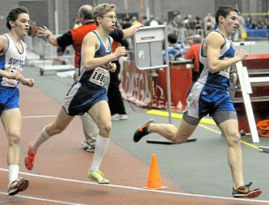 Lewis Mills' Patrick Claffey, right, runs in the 1,000 meter race at the Class M indoor track championship at the Floyd Little Athletic Center in New Haven. Photo by Peter Hvizdak/New Haven Register Photo: New Haven Register / ©Peter Hvizdak /  New Haven Register