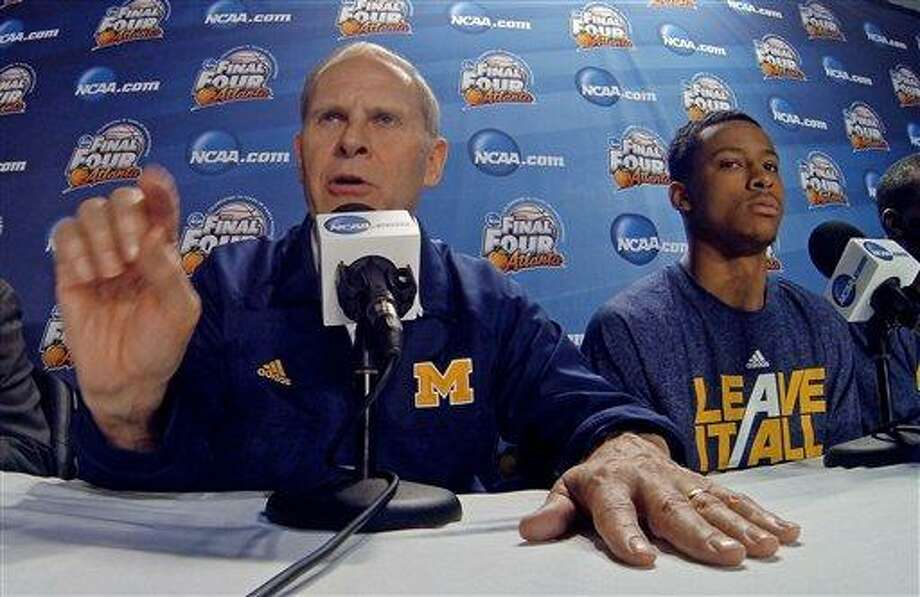 Michigan head coach John Beilein answers a question during a news conference for their NCAA Final Four tournament college basketball game Sunday, April 7, 2013, in Atlanta. Michigan plays Louisville in the championship game on Monday. (AP Photo/Tim Donnelly) Photo: AP / AP