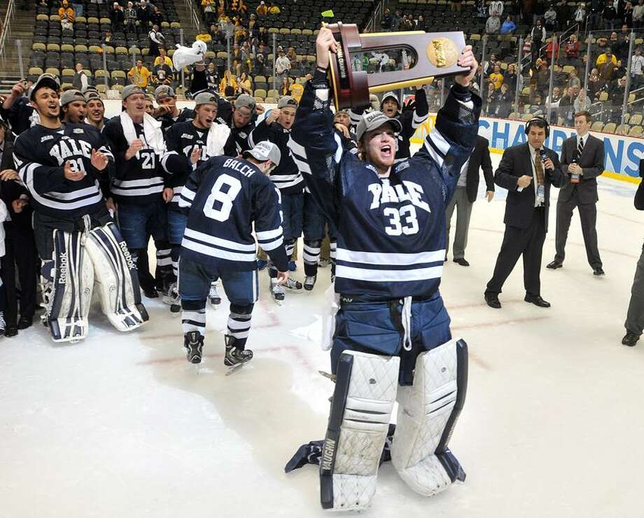 """Pittsburg, PA-- Yale celebrates their win over Quinnipiac for the NCAA Hockey National Championship.  Photo-Peter Casolino/Register <a href=""""mailto:pcasolino@newhavenregister.com"""">pcasolino@newhavenregister.com</a>"""