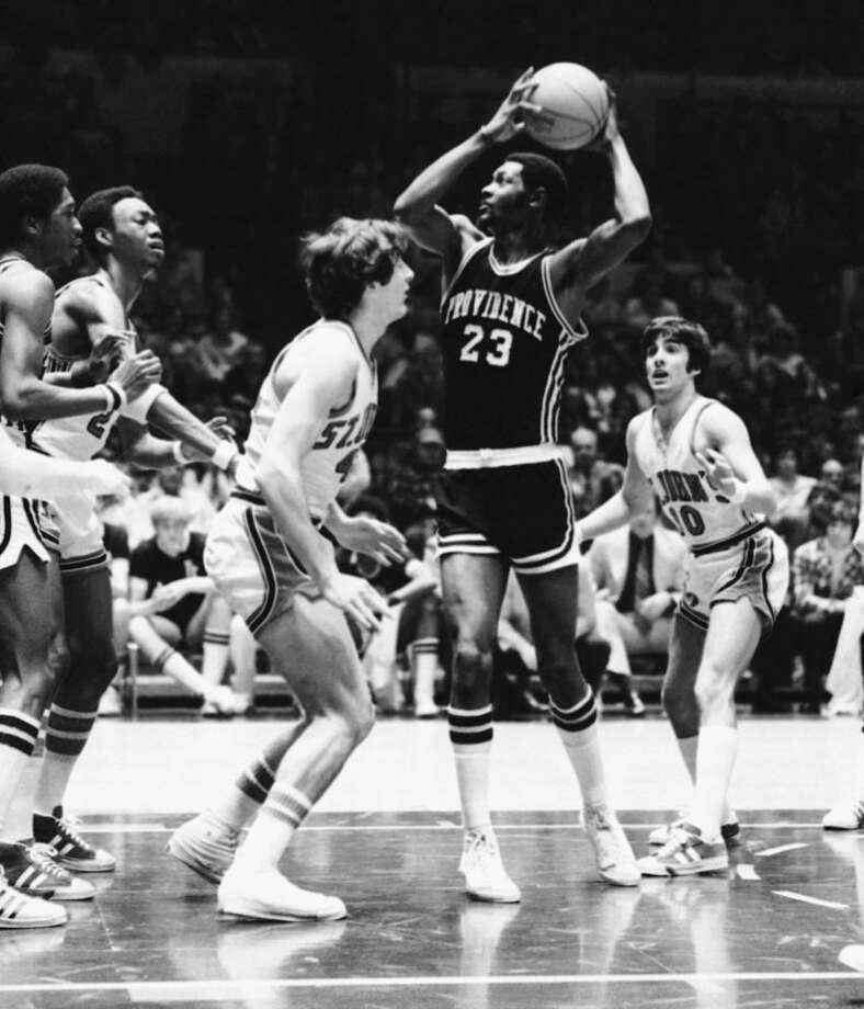 Bruce Campbell (23) of Providence prepares to put the ball up for a goal as John Farmer, left, and Frank Alagria (10) of St. John's move in during the first half of a National Invitation Tournament semifinal game, Saturday, March 22, 1975 at New York's Madison Square Garden. (AP Photo/Suzanne Vlamis) Photo: ASSOCIATED PRESS / AP1975