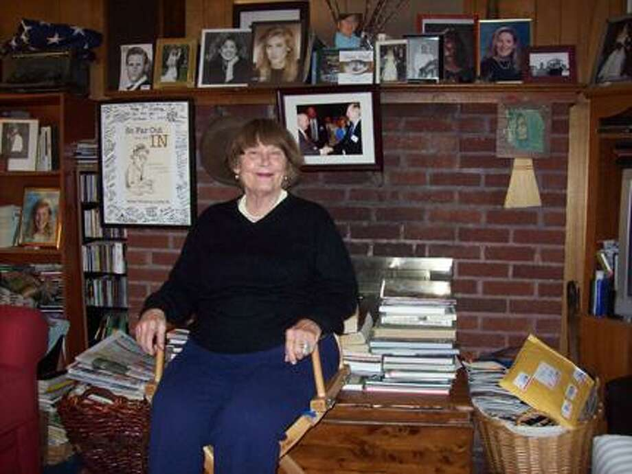 Photo Special to the Dispatch by MIKE JAQUAYS Present Company Productions co-founder Maria Curley sits in her autographed director's chair in her Oneida home.