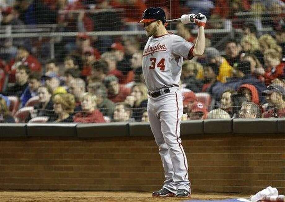 Washington Nationals' Bryce Harper prepares to bat against the Cincinnati Reds in a baseball game, Friday, April 5, 2013, in Cincinnati. (AP Photo/Al Behrman) Photo: AP / AP