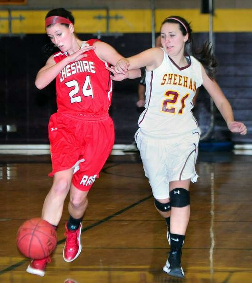 Molly Jalbert (left) of Cheshire and Cassie Strickand (right) of Sheehan go after a loose ball in the first half on 2/4/2013.Photo by Arnold Gold/New Haven Register   AG0482F