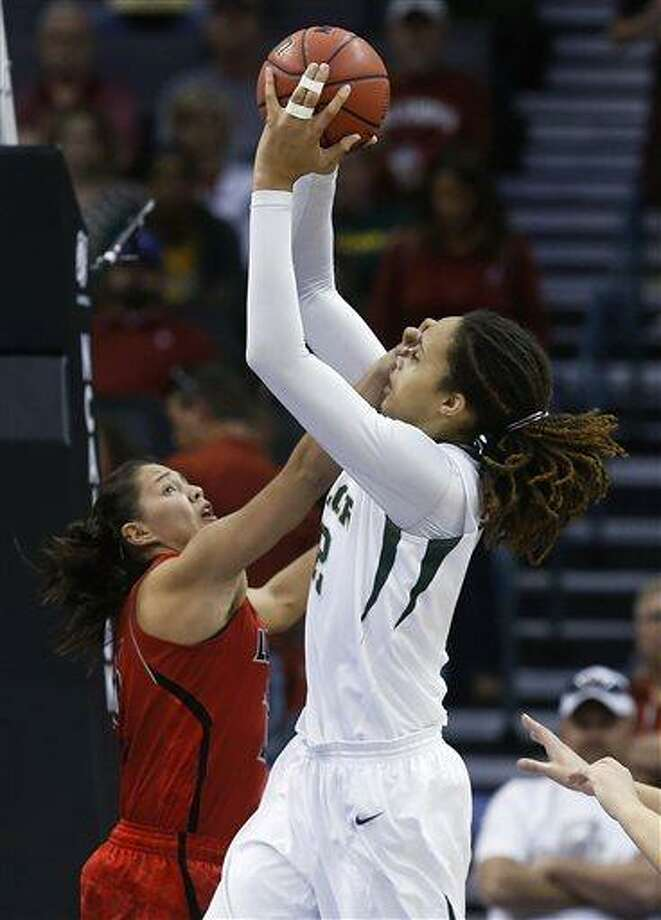Baylor 's Brittney Griner (42) shoots as Louisville guard Shoni Schimmel (23) defends in the first half of a regional semifinal game in the women's NCAA college basketball tournament in Oklahoma City, Sunday, March 31, 2013. (AP Photo/Sue Ogrocki) Photo: AP / AP