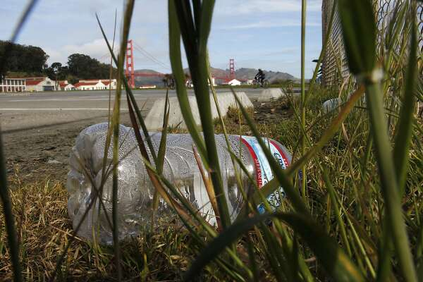 A discarded plastic bottle at Crissy Field on Tuesday Mar. 26, 2013, in San Francisco, Ca.  Members of the San Francisco Board of Supervisors along with the group Corporate Accountability International are behind a campaign to get the Golden Gate National Recreation Area and Yosemite National Park to stop selling bottled water and switch to water refill stations and drinking fountains.