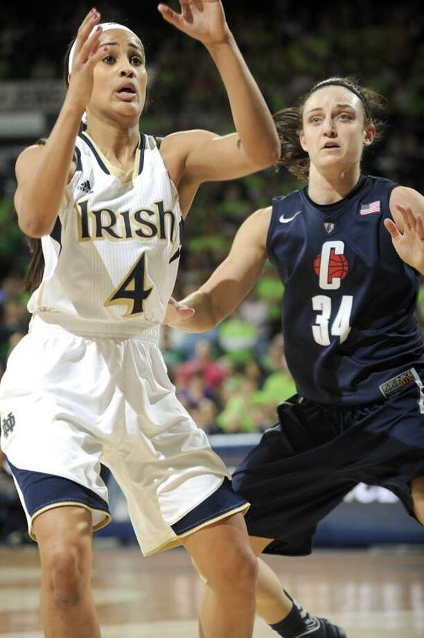Notre Dame guard Skylar Diggins, left, calls for a pass as Connecticut guard Kelly Faris defends in a college basketball game Monday March 4, 2013 in South Bend, Ind. (AP Photo/Joe Raymond) Photo: AP / AP2013