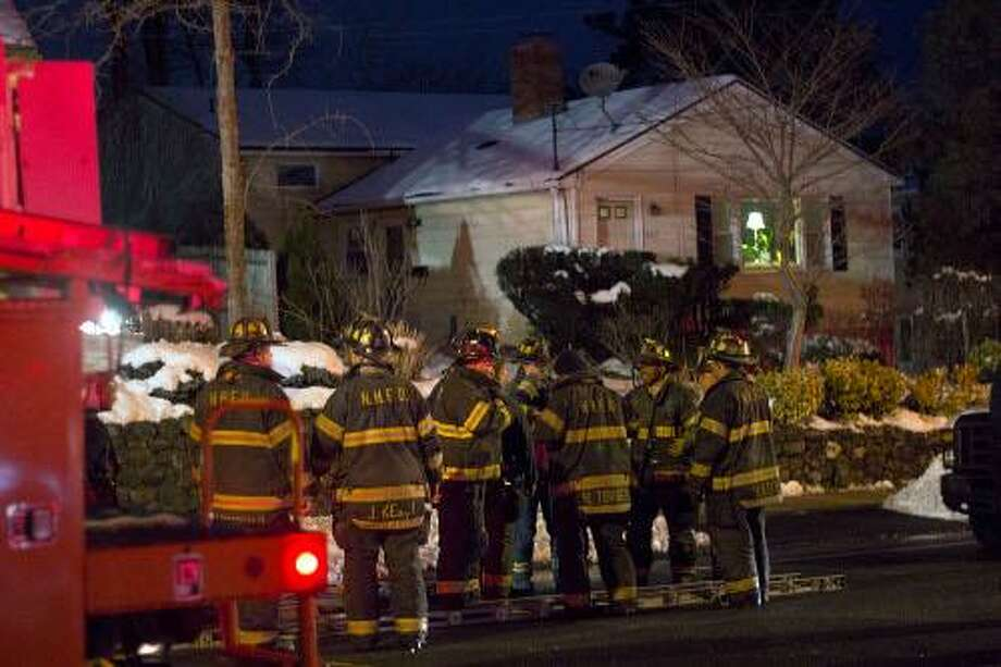 Firefighters gather after putting out a blaze on Fountain Street Friday night